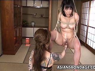Asian bondage babe is fisted