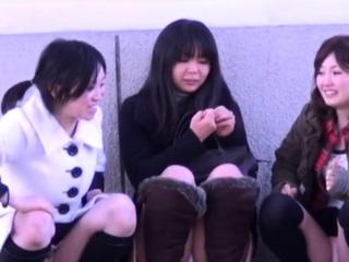 Asian babes get filmed upskirt