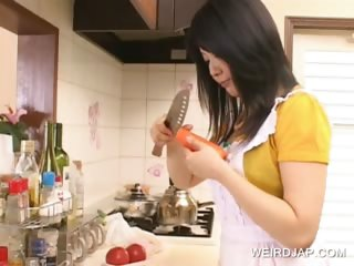Asian hottie having fun in the larder